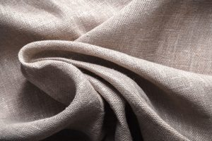 Background made of linen folded napkins horizontal