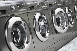 row-of-washing-machines-in-a-public-laundromat-P6M5UWA